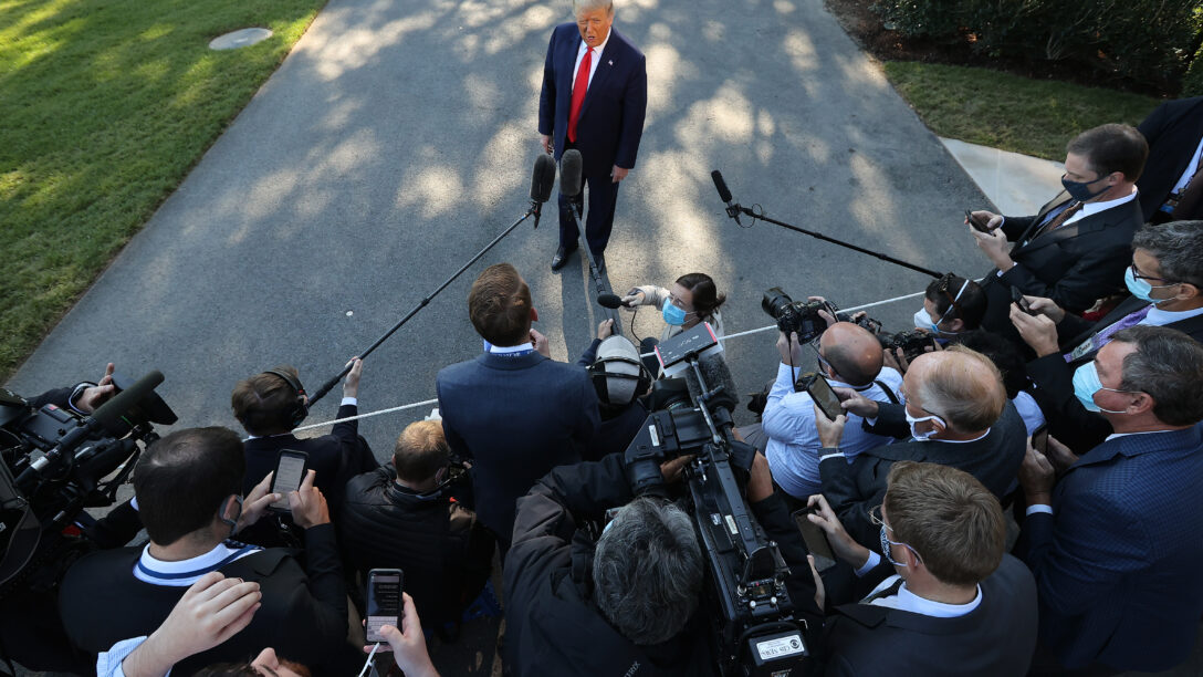 Donald Trump talks to reporters as he departs the White House